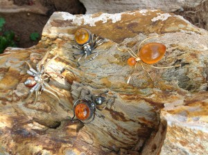 The Amber spiders are Baltic. The Rhinestone spider just worked nicely with the others. On a petrified log in our back yard.